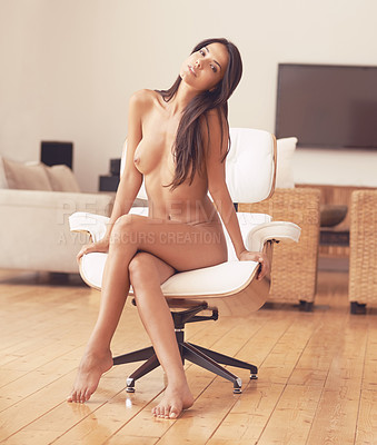 Buy stock photo A beautiful woman posing nude in her home