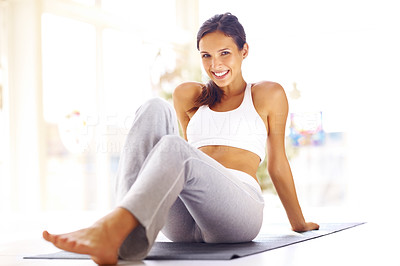 Buy stock photo Portrait of beautiful young woman relaxing on fitness mat after exercising - Indoors