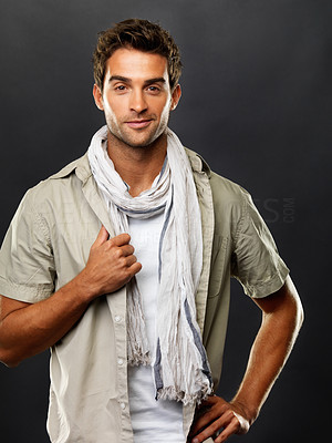 Buy stock photo Handsome young man posing against a dark background in casual wear