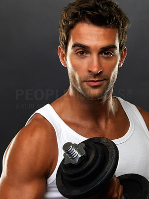 Buy stock photo Portrait of man lifting weights on black background