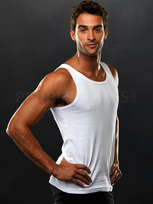 Buy stock photo Portrait of man in vest standing with hands on hips and smiling against black background