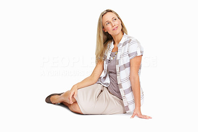Buy stock photo Full length of beautiful mature woman sitting over white background, looking away