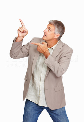 Buy stock photo Studio shot of a mature man showing you something against a white background