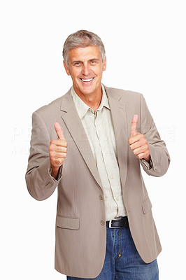 Buy stock photo Studio shot of a mature man giving thumbs up against a white background