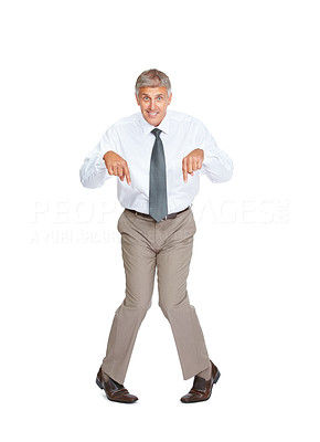 Buy stock photo Studio shot of a mature businessman being silly against a white background