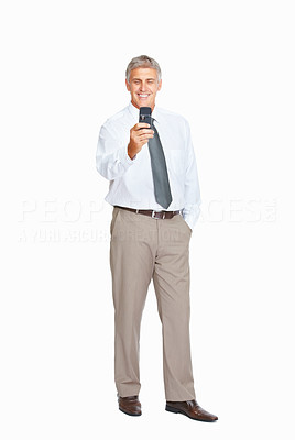 Buy stock photo Studio shot of a mature businessman using a mobile phone against a white background