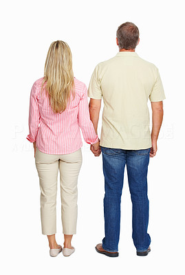Buy stock photo Rear view of happy mature couple holding hands over white background