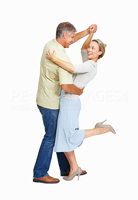 Buy stock photo Full length of mature couple enjoying dance over white background