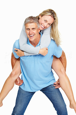 Buy stock photo Portrait of mature man giving woman piggy back over white background