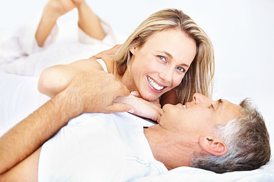 Buy stock photo Portrait of couple relaxing in bedroom and smiling