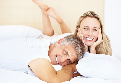 Buy stock photo Portrait of happy mature couple resting in bed at home