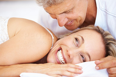 Buy stock photo Closeup of beautiful woman looking at man in bed