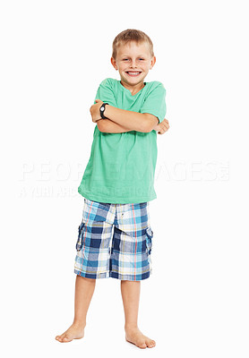 Buy stock photo Full length of naughty young boy with arms crossed over white background
