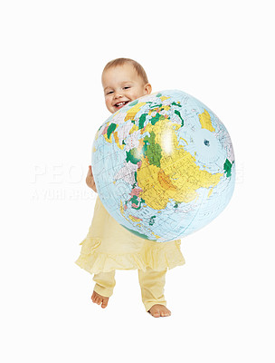 Buy stock photo Full length of an adorable toddler holding globe over white background