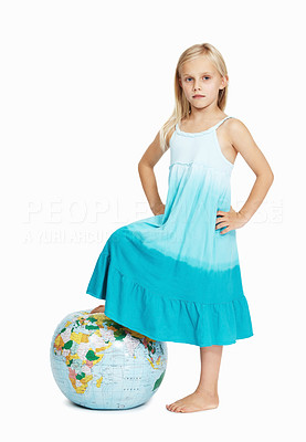 Buy stock photo Portrait of girl putting her foot on the globe over white background
