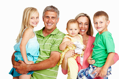 Buy stock photo Portrait of a loving family standing together against a white background