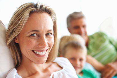 Buy stock photo Closeup of smiling beautiful woman with family in the background