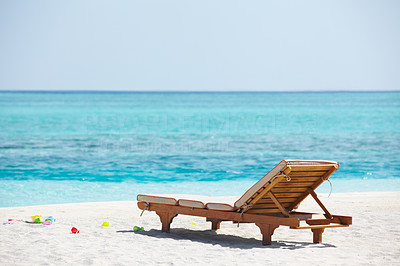 Buy stock photo An attractive image of a beach with resting chair