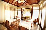 Beautiful spa therapy room with massage beds
