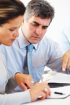 Buy stock photo Portrait of serious business man and woman reading document in office