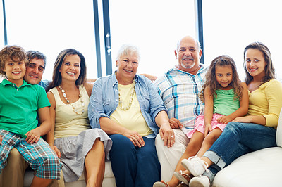 Buy stock photo Family portrait - Family of cheerful three generation family sitting together on a couch