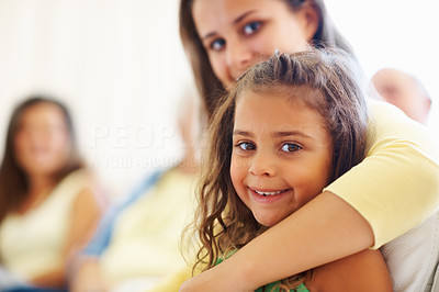 Buy stock photo Closeup portrait of two cute sisters with family in the background