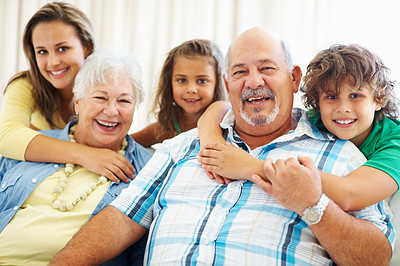 Buy stock photo Portrait of a happy senior couple with their grand children having a good time