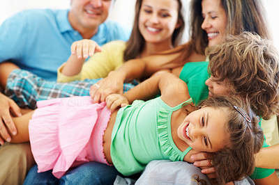 Buy stock photo Portrait of happy parents with children having a good time