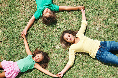 Buy stock photo Top view of kids holding hands and lying on grass , forming a circle