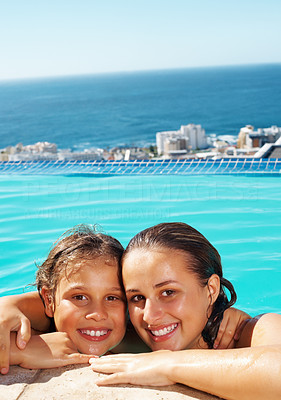 Buy stock photo Closeup of two sisters resting on the edge of swimming pool