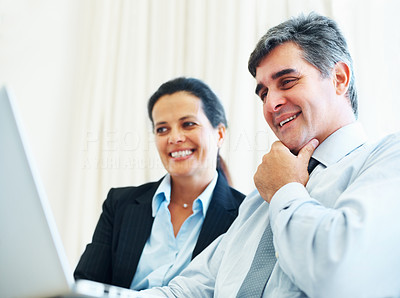 Buy stock photo Portrait of successful happy mature business couple using laptop