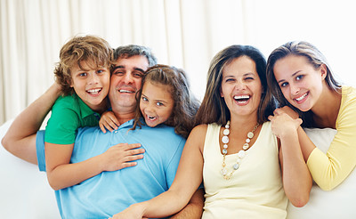 Buy stock photo Happy mature parents with son and daughters spending time together at home