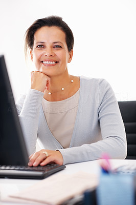 Buy stock photo Beautiful business woman sitting at her desk with hand on chin