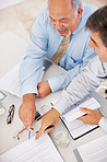 Male executives with business documents at work