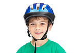 Adorable little  boy wearing a helmet