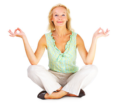 Buy stock photo Full body studio shot of a mature woman sitting on the floor in the lotus position isolated on white