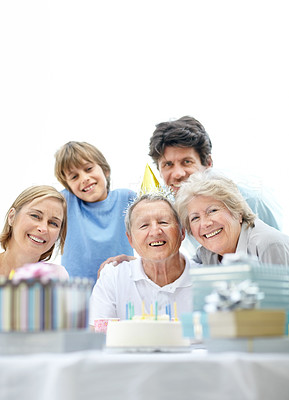 Happy old man celebrating his birthday with his family