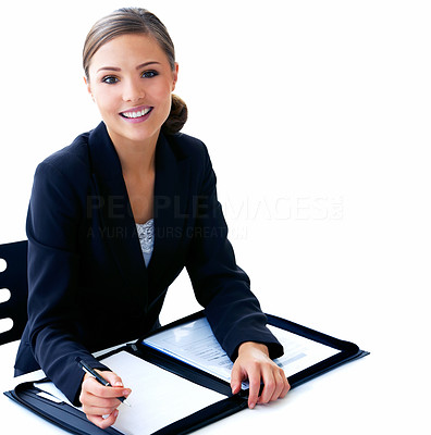 Buy stock photo Shot of a beautiful young businesswoman looking over papework