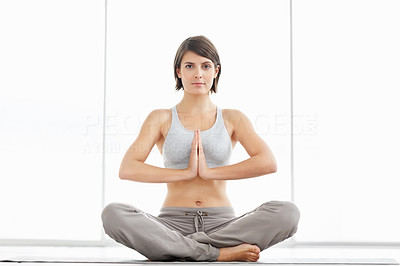 Fitness woman practicing yoga in the lotus position