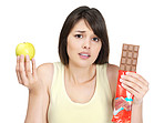 Confused over choice - Woman with apple and chocolate