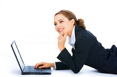 Buy stock photo Portrait of an adorable business woman lying down working on a laptop. Isolate taken in our studio.