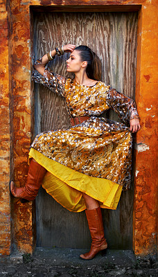Buy stock photo Shot of a stylishly dressed young woman in a doorway