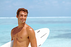 Smart young man with a surfboard at the beach