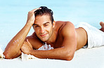 Male fashion model posing at the beach
