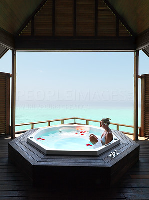 Mature woman relaxing in a jacuzzi