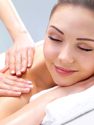 Buy stock photo Getting a massage - smiling face. Portrait of a pretty young girl getting a massage at the day spa