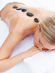 Woman receiving a hot stone treatment at the dayspa