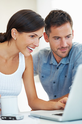 Surprised woman with man working on laptop