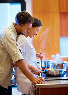 Happy couple preparing food together