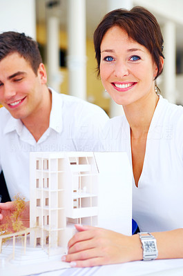 Buy stock photo Cropped shot of two architect discussing work in the boardroom